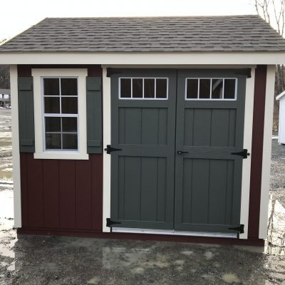 10′ x 10′ Shedman Special A-Frame Shed red with white trim and green doors